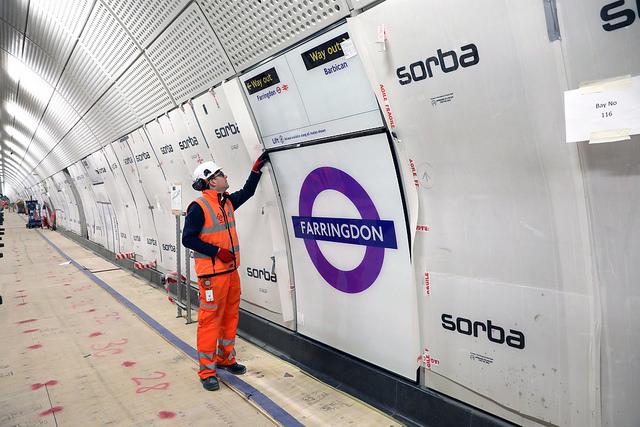 Platform roundels being installed at Farringdon.
