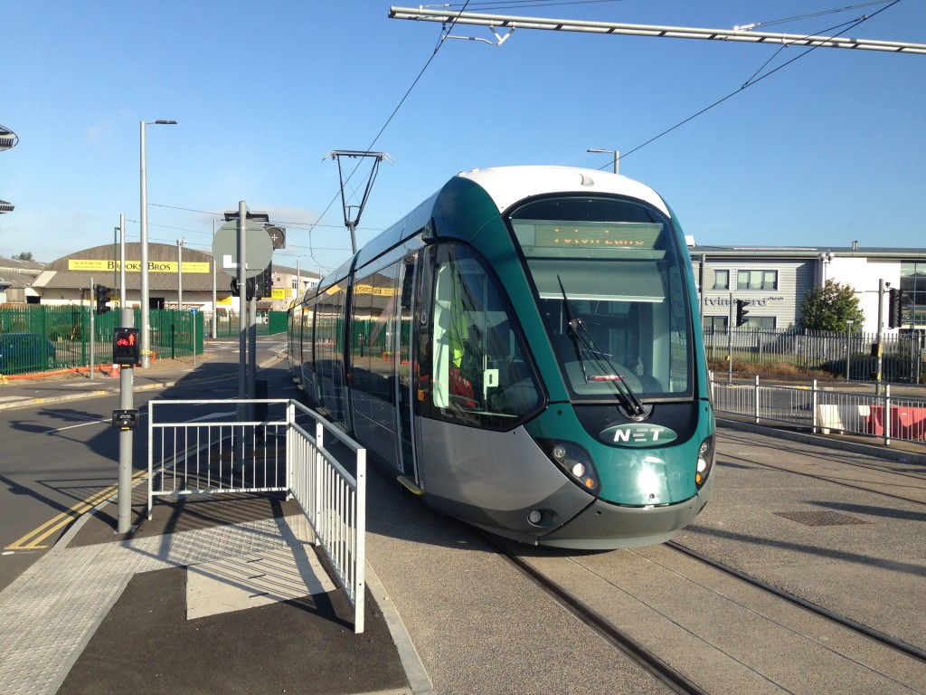 A NET Alstom Citadis tram bound for Toton Lane crosses the road onto Gregory Street, Nottingham.