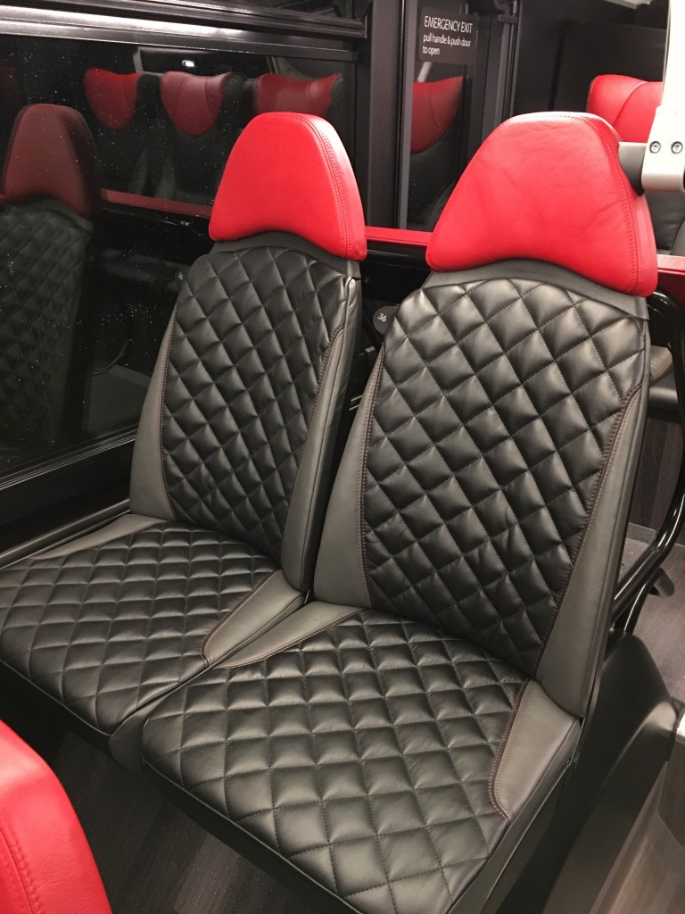 Cushioned leather seats downstairs.