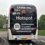 Novel advertising on the back of a National Express coach - imagine trying to explain this to the police officer as you're pulled over for using your wifi enabled device at the wheel? Image credit: .Camilo on Flickr.